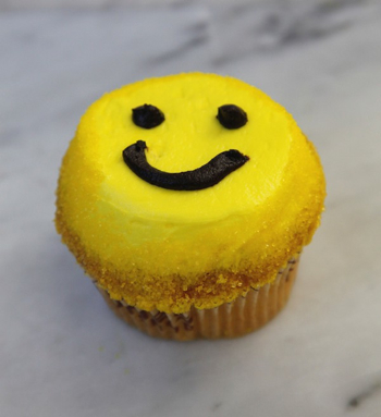 Crumbs smiley face cupcake