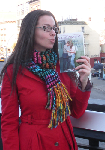 Susane Colasanti kissing an ARC of Keep Holding On